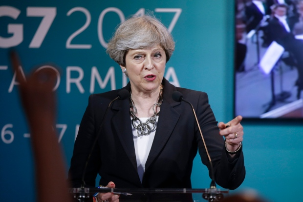 May blasts opponent on Brexit as poll lead narrows