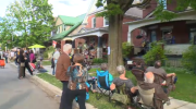 Residents gather on Hohner Avenue for the yearly porch party. (May 28, 2017)