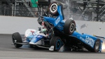 Scott Dixon, of New Zealand, begins to go over the top of Jay Howard, of England, during the running of the Indianapolis 500 auto race at Indianapolis Motor Speedway, Sunday, May 28, 2017, in Indianapolis. (AP Photo/Bill Friel)