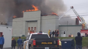 Police are treating a fire that burned down the old St. Agnes school in New Waterford, N.S., as suspicious.