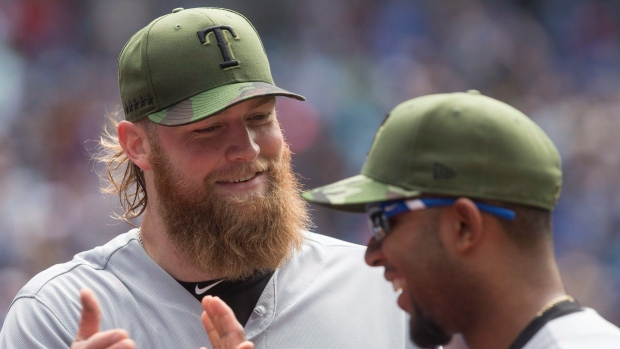 Texas Rangers starting pitcher Andrew Cashner (left) and Rangers shortstop Elvis Andrus react as they close out the fifth inning against the Toronto Blue Jays during Major League baseball action in Toronto on Sunday, May 28, 2017. (THE CANADIAN PRESS/Chris Young)