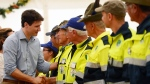 Prime Minister Justin Trudeau shakes hands with locals as he visits Amatrice, Italy on Sunday, May 28, 2017. The area was effected by an earthquake that occured in August 2016. THE CANADIAN PRESS/Sean Kilpatrick