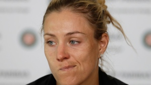 Germany's Angelique Kerber grimaces during a press conference after losing to Russia's Ekaterina Makarova in their first round match of the French Open tennis tournament at the Roland Garros stadium, Sunday, May 28, 2017 in Paris. (AP Photo/Petr David Josek)