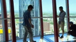 Tourists on the glass floor of the Calgary Tower