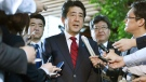 Japanese Prime Minister Shinzo Abe, center, answers to a reporter's question about North Korea's missile launch, at his official residence in Tokyo Monday morning, May 29, 2017. (Muneyuki Tomari/Kyodo News via AP)