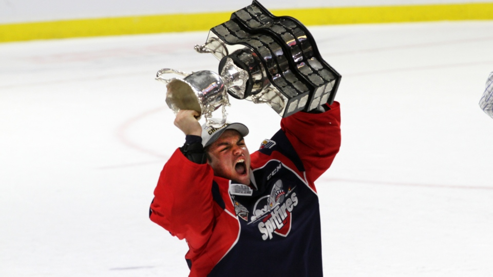 Michael DiPietro hoists the Memorial Cup after the Windsor Spitfires defeated the Erie Otters in the final of the 2017 Mastercard Memorial Cup in Windsor, Ont., on Sunday, May 28, 2017. (Melanie Borrelli / CTV Windsor)