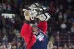 Windsor Spitfires goalie Michael DiPietro hoists the trophy after defeating the Erie Otters to win the Memorial Cup in Windsor, Ont., on Sunday, May 28, 2017. (Adrian Wyld / THE CANADIAN PRESS)
