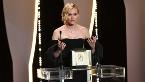 Diane Kruger was overcome with emotion after winning the Best Actress prize for her role in Fatih Akin's 'In the Fade.' (© Alberto PIZZOLI / AFP)