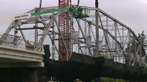 After two failed attempts last week, crews hope to move the 12 Street Bridge by crane on Monday.
