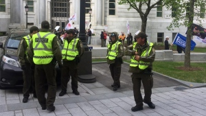 Sureté du Quebec officers are at every entrance of the National Assembly on Monday May 29, 2017 (CTV Montreal/Maya Johnson)
