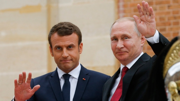 Vladimir Putin, right, and Emmanuel Macron