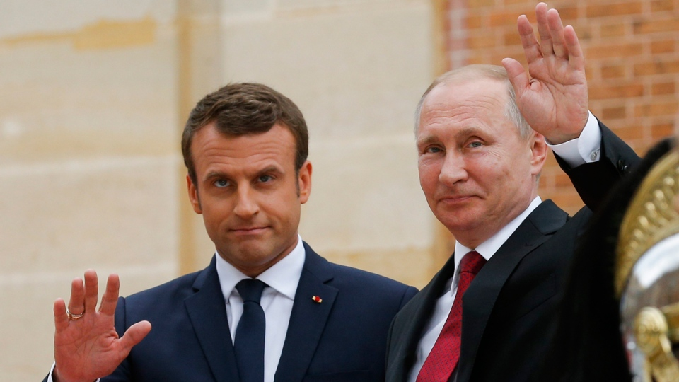 Russian President Vladimir Putin, right, and French President Emmanuel Macron at the Palace of Versailles, near Paris, France, on May 29, 2017. (Alexander Zemlianichenko / AP)