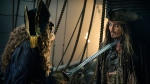"""In this image released by Disney, Geoffrey Rush portrays Barbossa, left, and Johnny Depp portrays Captain Jack Sparrow in a scene from """"Pirates of the Caribbean: Dead Men Tell No Tales."""" (Peter Mountain / Disney via AP)"""