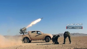 This Thursday, May 25, 2017 photo provided by the government-controlled Syrian Central Military Media, shows Syrian government troops firing multiple launcher rockets at insurgent group's position, in the Syrian province of Homs. (Syrian Central Military Media, via AP)