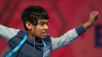 FILE - In this May 26, 2016, file photo, Nihar Janga of Austin, Texas, reacts to correctly spelling a word during the final round of the Scripps National Spelling Bee in Oxon Hill, Md. (AP Photo/Cliff Owen, File)