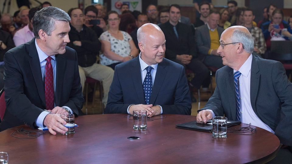 Nova Scotia Liberal leader Stephen McNeil, Progressive Conservative leader Jamie Baillie and NDP leader Gary Burrill, left to right, have a chat before the start of a leaders' round table at Saint Mary's University in Halifax on May 25, 2017. (Andrew Vaughan / The Canadian Press)