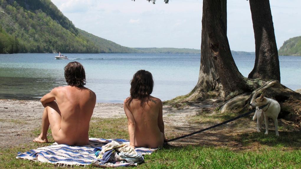 Vermont nude beach fans against parking lot, boardwalk
