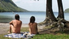 In this Thursday, May 18, 2017 photo, Michael Zarnowski, left, and Katelyn Comeau, of Thornton, N.H., relax at the clothing-optional beach known as the Southwest Cove of Lake Willoughby in Westmore, Vt. (AP Photo/Wilson Ring)