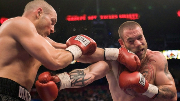Adrian Diaconu, right, lands a left to the jaw of David Whittom during their light heavyweight bout in Montreal Saturday, April 4, 2009. Journeyman boxer Whittom was in an induced coma at Saint John Regional Hospital on Monday following surgery to treat bleeding on the brain after a knockout loss. (THE CANADIAN PRESS/Ryan Remiorz)
