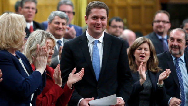 Conservative Leader Andrew Scheer receives a standing ovation in the House of Commons during Question Period on Parliament in Ottawa, Monday, May 29, 2017. (Fred Chartrand/The Canadian Press)