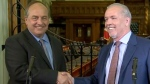 B.C. NDP Leader John Horgan and B.C. Green Party Leader Andrew Weaver shake hands after making an announcement on Monday, May 29, 2017.