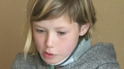 Girl in neck brace after being hit by truck
