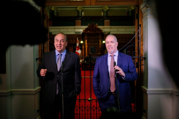B.C. Green party leader Andrew Weaver and B.C. NDP leader John Horgan speak to media after announcing they'll be working together to help form a minority government during a press conference at Legislature in Victoria, B.C., on Monday, May 29, 2017. (Chad Hipolito / THE CANADIAN PRESS)