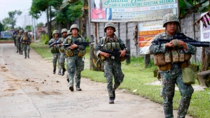 Philippine marines walk to the frontline in the continuing assaults to retake control of some areas of Marawi city Sunday, May 28, 2017 in southern Philippines. (Bullit Marquez/AP Photo)