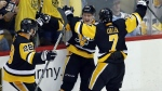 Pittsburgh Penguins' Jake Guentzel, center, celebrates his goal against the Nashville Predators with Ian Cole, left, and Matt Cullen during the third period in Game 1 of the NHL hockey Stanley Cup Finals, Monday, May 29, 2017, in Pittsburgh. (AP / Gene J. Puskar)