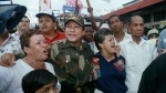 In this May 2, 1989 file photo, Gen. Manuel Antonio Noriega walks with supporters in the Chorrilo neighborhood, where he dedicated a new housing project, in Panama City. (AP / John Hopper, File)