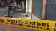 A man was stabbed Monday night during what police say appears to be a street robbery near Jarvis and Queen streets. (Mike Nguyen/ CP24)
