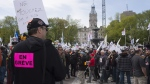 Thousands of striking construction workers demonstrate against a special legislation that will force them back to work, Monday, May 29, 2017 at the legislature in Quebec City. THE CANADIAN PRESS/Jacques Boissinot