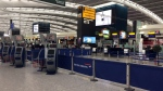 A view of Terminal 5 check in desks, at London's Heathrow airport after flights were canceled due to the airport suffering an IT systems failure, Saturday, May 27, 2017. (AP / Jo Kearney)