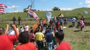 In this Aug. 12, 2016, file photo, Native Americans protest the Dakota Access oil pipeline near the Standing Rock Sioux Reservation in southern North Dakota. (AP Photo/James MacPherson, File)