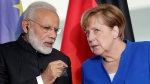German Chancellor Angela Merkel, right, and the Prime Minister of India, Narendra Modi, left, talk during a contract signing ceremony as part of a meeting at the chancellery in Berlin, Germany, May 30, 2017. (Michael Sohn/AP)