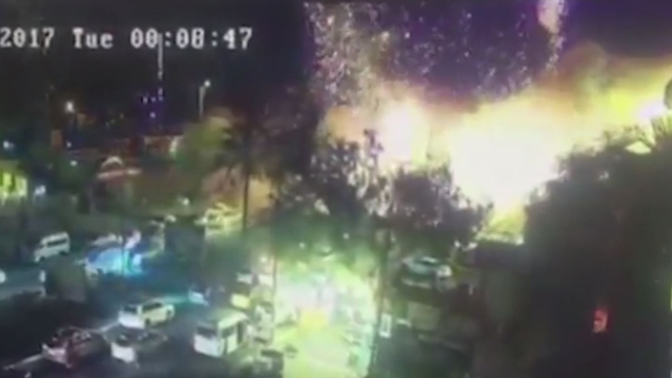 This screengrab shows the blast when a car bomb exploded outside an ice cream shop in central Baghdad, according to Iraqi officials. (Baghdad Operations Command via CNN)