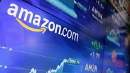 The Amazon logo is displayed at the Nasdaq MarketSite, in New York's Times Square, Tuesday, May 30, 2017. Online retail giant Amazon.com traded above $1,000 a share for the first time. (AP Photo/Richard Drew)