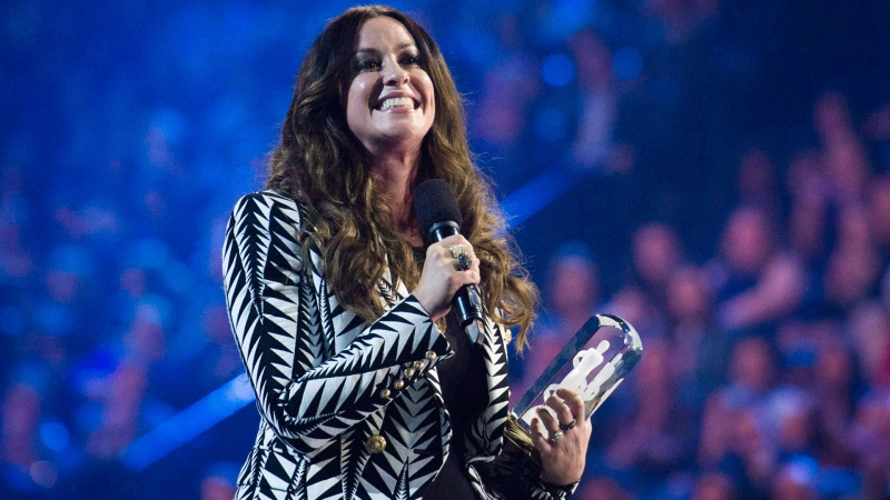 Artist Alanis Morissette receives her achievement from the Canadian Music Hall of Fame during the 2015 Juno Awards in Hamilton, Ont., on Sunday, March 15, 2015. THE CANADIAN PRESS/Nathan Denette