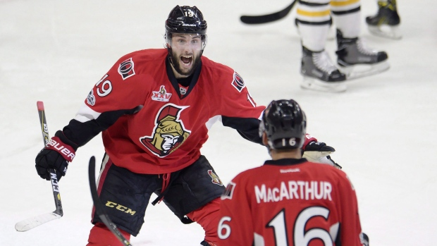 Ottawa Senators centre Derick Brassard (19) celebrates with left wing Clarke MacArthur (16) after scoring against the Pittsburgh Penguins during the first period of game three of the Eastern Conference final in the NHL Stanley Cup hockey playoffs in Ottawa on Wednesday, May 17, 2017. (Adrian Wyld/THE CANADIAN PRESS)