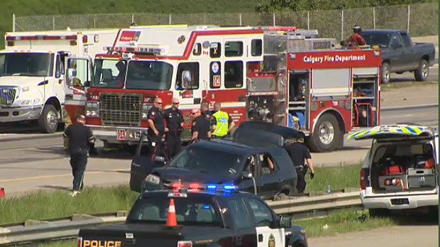 Two paramedics and a police officers were injured in an altercation with a man inside a vehicle following the crash.
