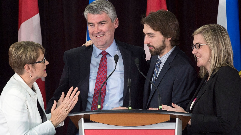 Nova Scotia Premier Stephen McNeil is embraced by his wife Andrea, daughter Colleen and son Jeffrey as he addresses the crowd at his election night celebration in Bridgetown, N.S. on Tuesday, May 30, 2017. THE CANADIAN PRESS/Andrew Vaughan