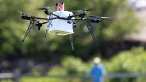 In this June 22, 2016, file photo, a drone aircraft flies during a ship-to-shore delivery simulation in Lower Township, N.J. (AP Photo/Mel Evans, File)