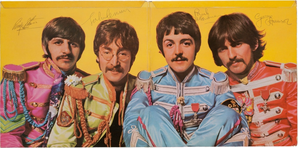 "This photo  shows a a copy of The Beatles' ""Sgt. Pepper's Lonely Hearts Club Band"" album autographed by all four band members. Paul McCartney (mid-right) can be seen with an Ontario Provincial Police patch attached to the arm of his jacket. (AP / Heritage Auctions)"