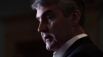 Nova Scotia Premier Stephen McNeil talks with reporters at the legislature in Halifax on Wednesday, May 31, 2017. (THE CANADIAN PRESS/Andrew Vaughan)