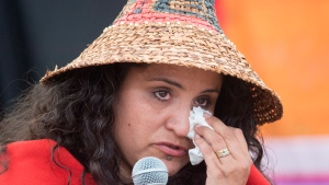 Helen Allan a member of the Jack family wipes away a tear as she speaks at the National Inquiry into Missing and Murdered Indigenous Women and Girls taking place in Whitehorse, Yukon, Thursday, June 1, 2017. (Jonathan Hayward / THE CANADIAN PRESS)