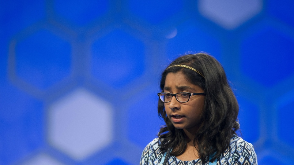 Ananya Vinay, 12, from Fresno, Calif., correctly spells 'verdaccio' during the finals of the 90th Scripps National Spelling Bee in Oxon Hill, Md. on Thursday, June 1, 2017. (AP / Cliff Owen)