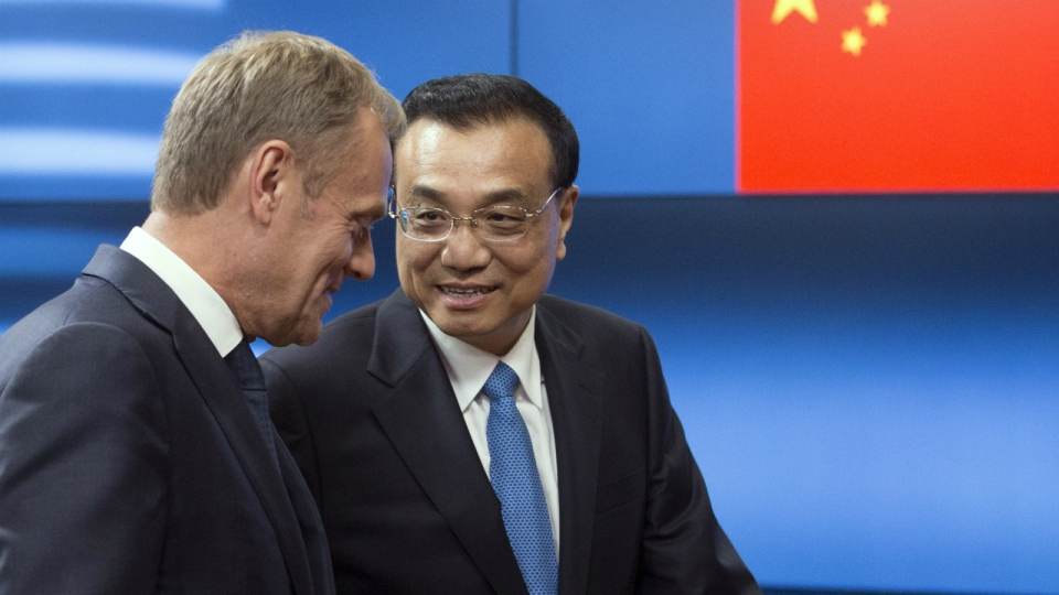 Chinese Premier Li Keqiang, right, speaks with European Council President Donald Tusk as he arrives prior to a meeting at the Europa building in Brussels on Thursday, June 1, 2017. (Olivier Hoslet / AP)