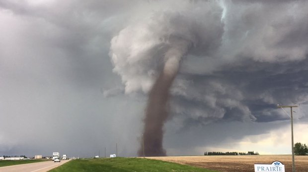 Tornado touches down near highway in Canada in dramatic video