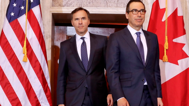 Treasury Secretary Steven Mnuchin walks with Canadian Finance Minister Bill Morneau before their bilateral meeting at the Treasury Department in Washington, on Wed., March 1, 2017. (AP / Pablo Martinez Monsivais)