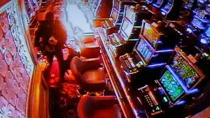Police authorities and Resorts World Manila complex security play a CCTV video of the gunman setting fire inside a casino during a news conference Saturday, June 3, 2017, in Pasay city, southeast of Manila, Philippines. (Bullit Marquez/AP Photo)